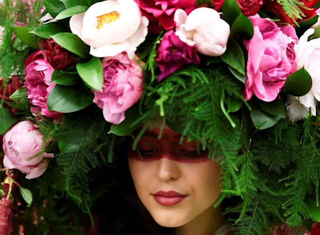 <p>A model wears a floral headdress at the Royal Horticultural Society's Chelsea Flower show in London, Britain, May 22, 2017. (Photo: Dylan Martinez/Reuters) </p>
