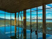 "<p>Set atop a bluff where the South American <em>pampa</em> (fertile plain) meets Lake Sarmiento, the 40-room <a href=""https://www.cntraveler.com/hotels/chile/torres-del-paine-national-park/tierra-patagonia-hotel---spa?mbid=synd_yahoo_rss"" rel=""nofollow noopener"" target=""_blank"" data-ylk=""slk:Tierra Patagonia"" class=""link rapid-noclick-resp"">Tierra Patagonia</a> is exactly where we'd want to find ourselves between the whipping winds: Clad in lenga beechwood and banked with earth, the walls of this low-slung hotel barely register the gales blowing over from Patagonia's Southern Ice Field. It's not all rough and tumble, though. Interiors at the hotel are spare but cozy, with wide, light wood-framed windows and white finishes throughout, and even a well-stocked library. Depending on your fitness level, set up a half- or full-day excursion to the Paso de Agostini, or the French Valley, to both get off-grid <em>and</em> have a dream setting to return to after long days hiking and biking.</p> <p><strong>Book now</strong>: <a href=""https://skylark.com/destinations/south-america/chile/patagonia/hotels/tierra-patagonia?utm_medium=partner&utm_source=cnt&utm_content=tierrapatagonia"" rel=""nofollow noopener"" target=""_blank"" data-ylk=""slk:skylark.com"" class=""link rapid-noclick-resp"">skylark.com</a></p>"
