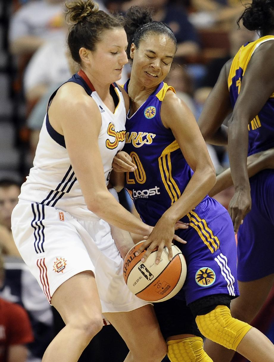 Connecticut Sun's Kelsey Griffin, left, and Los Angeles Sparks' Kristi Toliver, right, fight for control of the ball during the second half of a WNBA basketball game in Uncasville, Conn., Tuesday, Aug. 6, 2013. The Sparks won 74-72. (AP Photo/Jessica Hill)