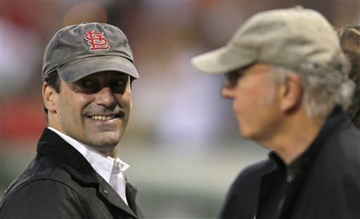 Actors Jon Hamm, left, and Larry David talk prior to a baseball game between the New York Yankees and the Boston Red Sox, Thursday, Sept. 13, 2012 at Fenway Park in Boston. (AP Photo/Charles Krupa)