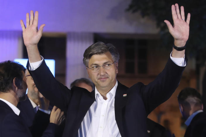 Andrej Plenkovic, Croatia's Prime Minister incumbent celebrates with his party members in Zagreb, Croatia, Sunday, July 5, 2020. The ruling conservatives overwhelmingly won Croatia's parliamentary elections held Sunday amid a spike in new coronavirus cases as the latest European Union member state leaned further to the right. (AP Photo)