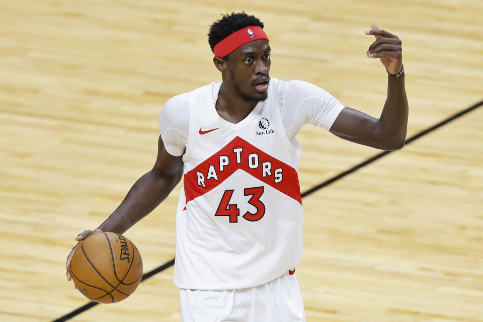 MIAMI, FLORIDA - FEBRUARY 24: Pascal Siakam #43 of the Toronto Raptors dribbles the ball up the court against the Miami Heat during the second quarter at American Airlines Arena on February 24, 2021 in Miami, Florida. NOTE TO USER: User expressly acknowledges and agrees that, by downloading and or using this photograph, User is consenting to the terms and conditions of the Getty Images License Agreement.  (Photo by Michael Reaves/Getty Images)
