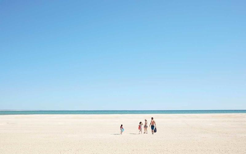 A family outing at Shell Beach. | Sean Fennessy