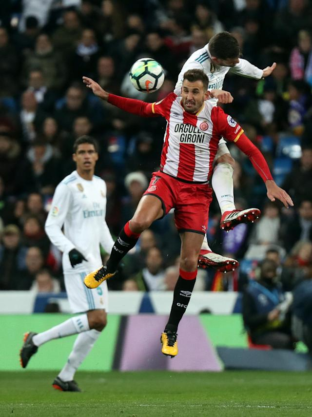 Soccer Football - La Liga Santander - Real Madrid vs Girona - Santiago Bernabeu, Madrid, Spain - March 18, 2018 Real Madrid's Nacho in action with Girona's Christian Stuani REUTERS/Sergio Perez