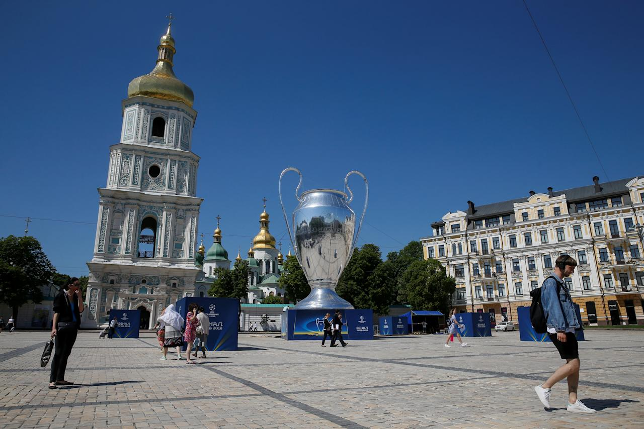 A giant replica of the UEFA Champions League trophy is on display near the Saint Sophia's Cathedral in central Kiev, Ukraine May 23, 2018. REUTERS/Valentyn Ogirenko