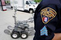 Cleveland police bomb squad technician Sgt. Tim Maffo-Judd demonstrates a Remotec F5A explosive ordnance device robot during a demonstration of police capabilities near the site of the Republican National Convention in Cleveland, Ohio, U.S. July 14, 2016. REUTERS/Rick Wilking
