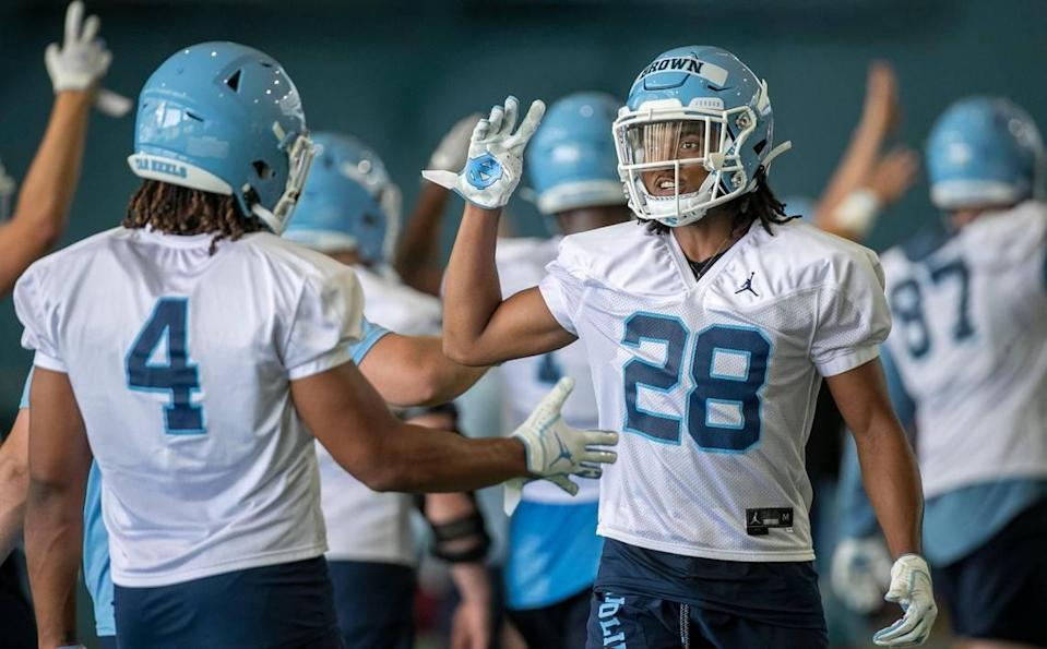 North Carolina defensive back Tymir Brown (28) and Trey Morrison (4) begin the final period of the Tar Heels' practice on Thursday, August 5, 2021 in Chapel Hill N.C