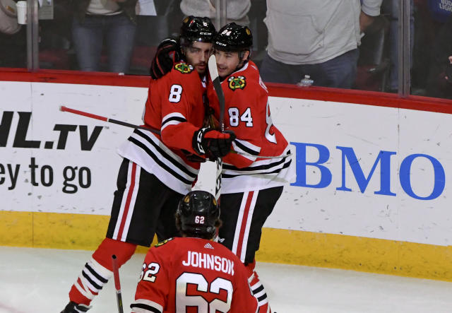 Chicago Blackhawks center Nick Schmaltz (8) hugs left wing Alexandre Fortin (84) after Fortin scored a goal against the New York Rangers during the second period of an NHL hockey game on Thursday Oct. 25, 2018, in Chicago. (AP Photo/Matt Marton)