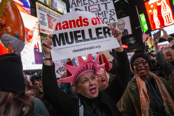 <p>People attend a protest the day after President Trump forced the resignation of Attorney General Jeff Sessions, in Times Square on Nov. 8, 2018, in New York City. (Photo: Eduardo Munoz Alvarez/Getty Images) </p>