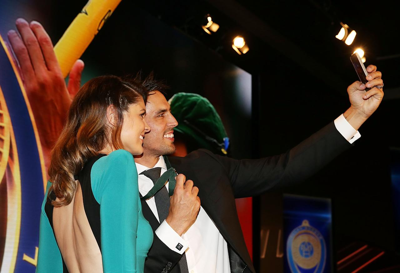 SYDNEY, AUSTRALIA - JANUARY 20:  Mitchell Johnson poses with his wife Jessica Bratich-Johnson after winning the Allan Border Medal during the 2014 Allan Border Medal at Doltone House on January 20, 2014 in Sydney,  (Photo by Mark Metcalfe/Getty Images)