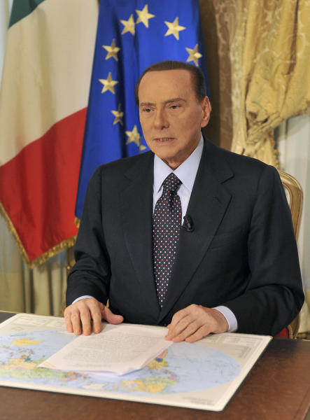 "In this photo released by the Berlusconi press office Thursday, Oct. 25, 2012, former Italian premier Silvio Berlusconi tapes a video message where he announces he will not run for a fourth term as premier in spring elections. Berlusconi has until now been coy about his intentions. But the three-time former premier posted a statement on his movement's website yesterday, under the headline: ""I won't run for premier."", following today with a video where he confirms his intentions. (AP Photo/Livio Anticoli, Berlusconi press office)"