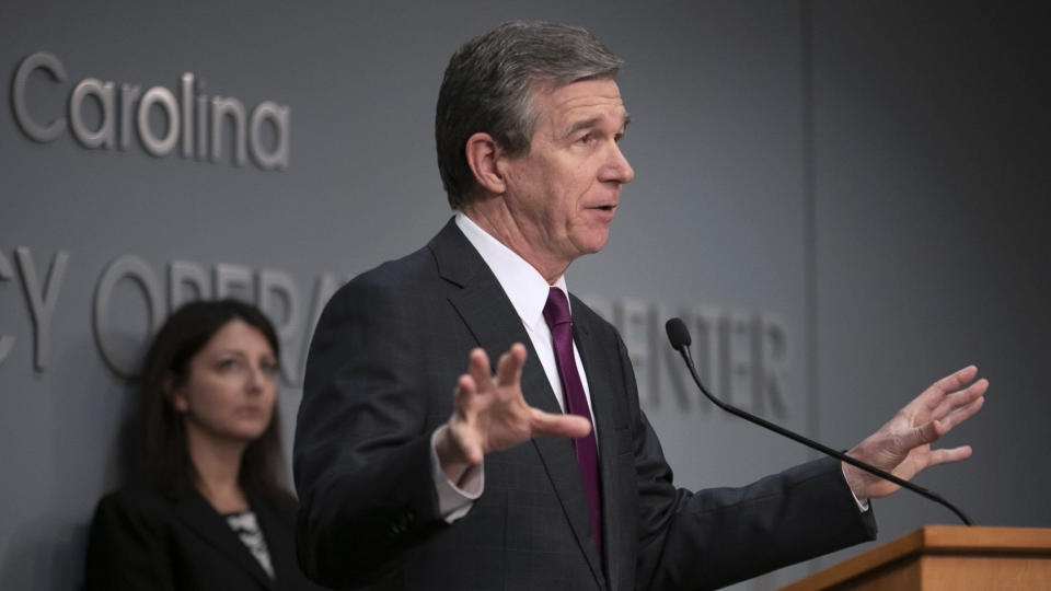 North Carolina Governor Roy Cooper speaks during a press briefing on the COVID-19 virus on Tuesday, April 21, 2020 at the Emergency Operations Center in Raleigh, N.C. (Robert Willett/The News & Observer via AP)