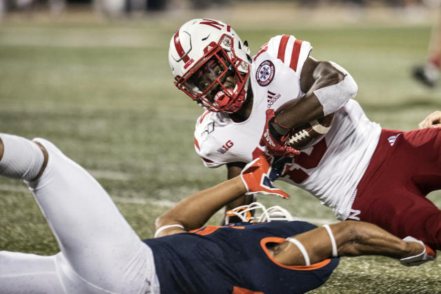 Nebraska's JD Spielman (10) is brought down by Illinois' Nolan Bernat (28) in the first half of an NCAA college football game, Saturday, Sept. 21, 2019, in Champaign, Ill. (AP Photo/Holly Hart)