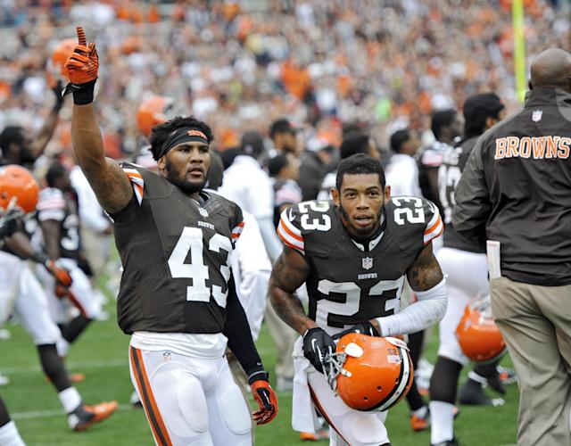 Cleveland Browns strong safety T.J. Ward (43) and cornerback Joe Haden (23) celebrate after a 17-6 win over the Cincinnati Bengals in an NFL football game Sunday, Sept. 29, 2013, in Cleveland. (AP Photo/David Richard)