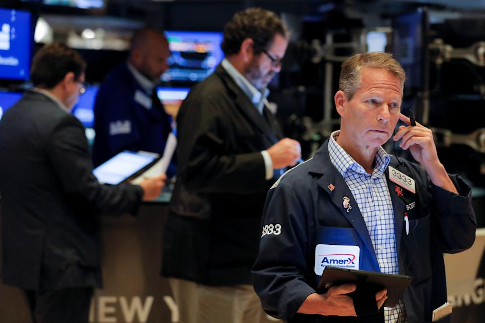 Traders work on the floor at the New York Stock Exchange (NYSE) in Manhattan, New York City, U.S., September 24, 2021. REUTERS/Andrew Kelly