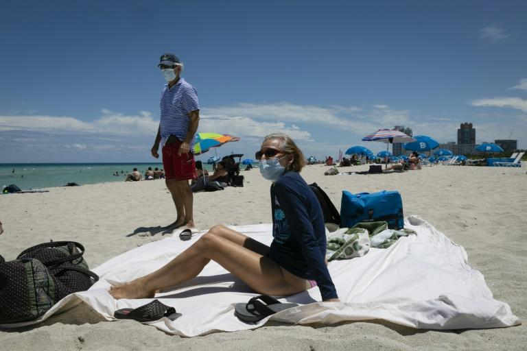 Several US states including tourism hub Florida are experiencing surges in coronavirus infections, raising concerns about the pace of ending lockdowns (AFP Photo/Eva Marie UZCATEGUI)