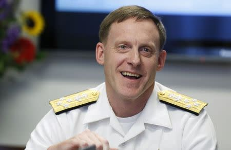 National Security Agency (NSA) Director Admiral Michael Rogers smiles at a Reuters CyberSecurity Summit in Washington