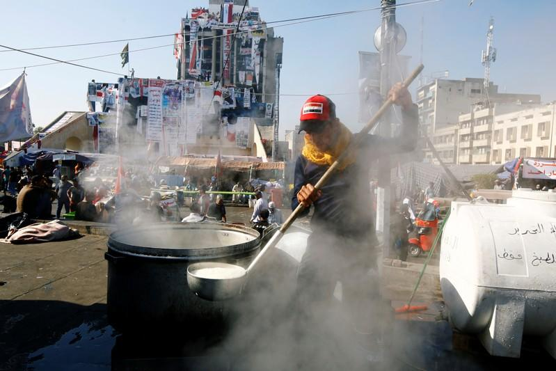 Demonstrator cooks during the ongoing anti-government protests in Baghdad