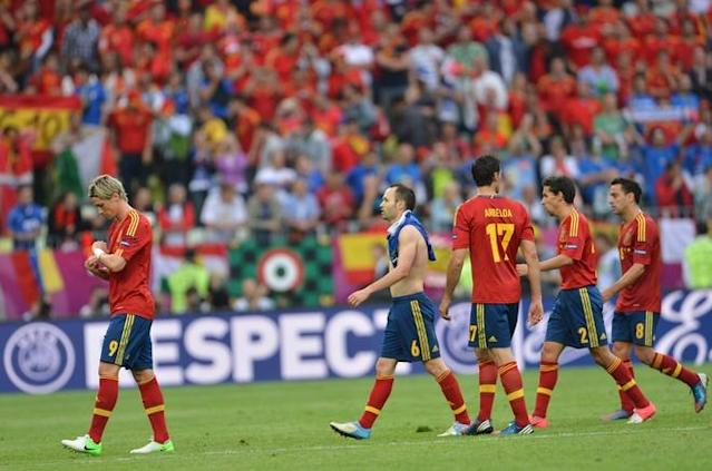 Spanish forward Fernando Torres (L) and Spanish midfielder Andres Iniesta (2ndL) leave with teammates the pitch at the end of the Euro 2012 championships football match Spain vs Italy on June 10, 2012 at the Gdansk Arena. AFP PHOTO/ GIUSEPPE CACACEGIUSEPPE CACACE/AFP/GettyImages