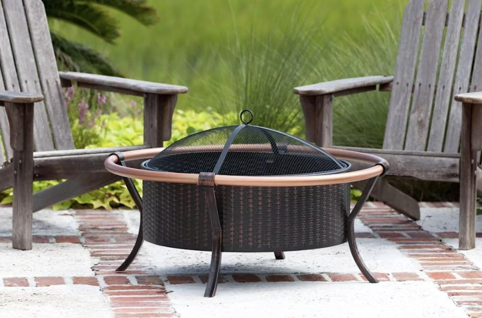 <p>Notice the sleek copper finish on this <span>Outdoor Fire Pit</span> ($150).</p>