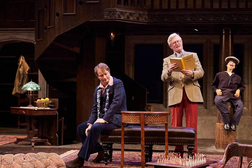 """Andrew (David Anthony Smith) reads from one of his mystery novels to Milo (Jeffrey C. Hawkins) in Great Lakes Theater's production of """"Sleuth."""" Directed by Charlie Fee, the show is now at the Idaho Shakespeare Festival."""