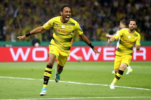 "<a class=""link rapid-noclick-resp"" href=""/soccer/players/pierre-emerick-aubameyang/"" data-ylk=""slk:Pierre-Emerick Aubameyang"">Pierre-Emerick Aubameyang</a> celebrates a goal for <a class=""link rapid-noclick-resp"" href=""/soccer/teams/borussia-dortmund/"" data-ylk=""slk:Borussia Dortmund"">Borussia Dortmund</a>. He is the most expensive player in <a class=""link rapid-noclick-resp"" href=""/soccer/teams/arsenal/"" data-ylk=""slk:Arsenal"">Arsenal</a> history. (Getty)"