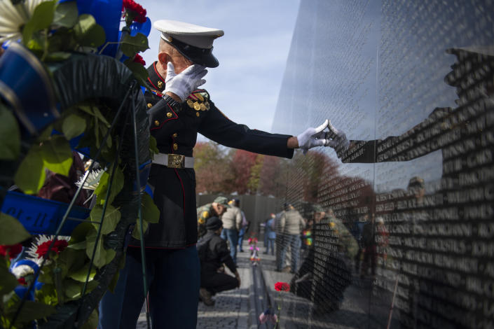 Retired Marine Paul Masi, of Bethpage, N.Y., pauses by the name of his high school classmate, Robert Zwerlein, at the Vietnam Veterans Memorial on Veterans Day, Monday, November 11, 2019. Masi served in the 7th Engineers in Vietnam. (Photo: Tom Williams/CQ-Roll Call, Inc via Getty Images)