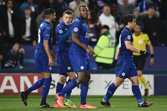Leicester City's Wes Morgan (3rd L)) celebrates with teammates after scoring a goal during their UEFA Champions League round of 16 2nd leg match against Sevilla, at the King Power Stadium in Leicester, on March 14, 2017 (AFP Photo/Oli Scarff)