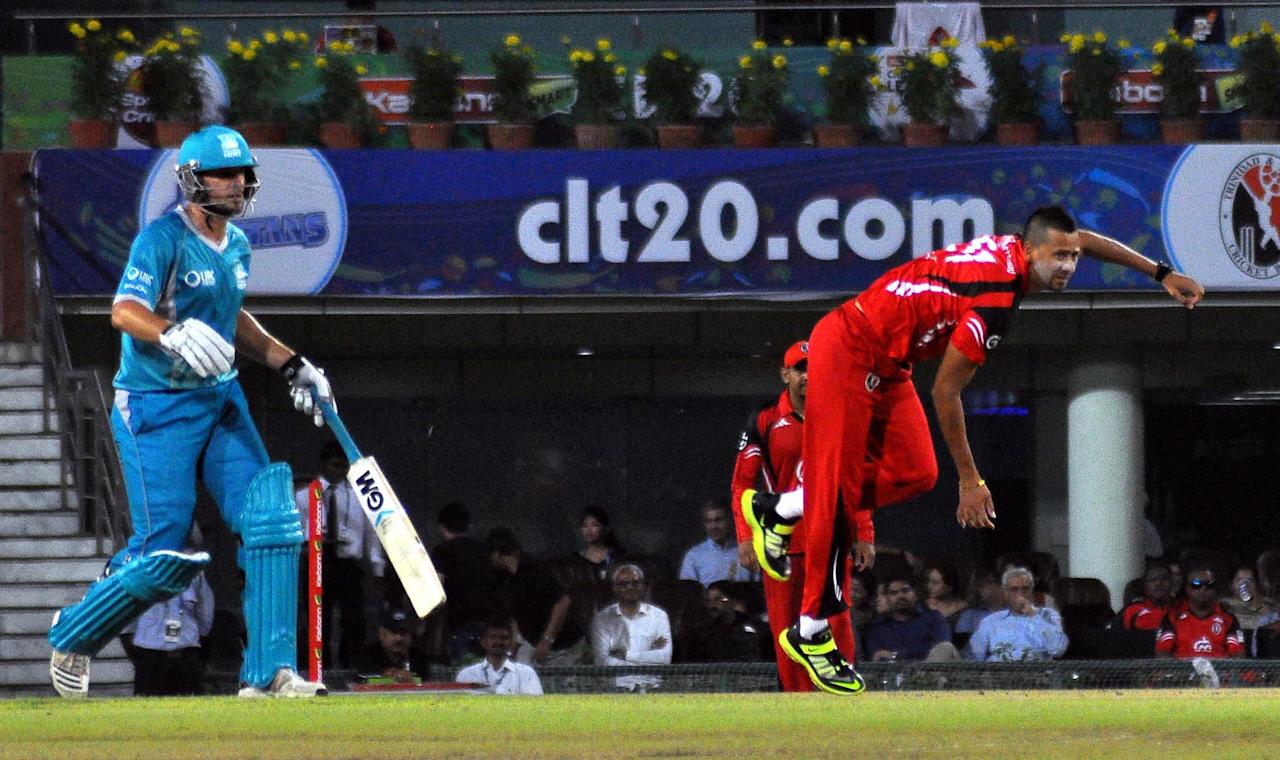 Players of Brisbane Heat in action during the Champions League T20, 2nd match, Group B between Brisbane Heat and Trinidad & Tobago at JSCA International Cricket Stadium, Ranchi on Sept. 22, 2013. (Photo: IANS)