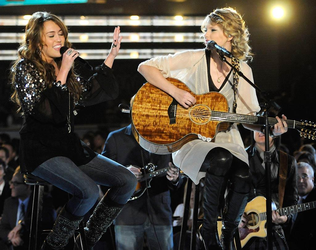 "Miley and another phenom, Taylor Swift, performed together at the Grammy Awards in 2009. Before their duet, Taylor admitted to MTV News that the country crooners-turned-pop tarts made a point not to talk about work together. ""We try and keep it friends and not discuss business and publicity,"" Taylor said. ""It's fun being able to be friends with someone who does the same thing that you do and not have that come into play."" Kevin Mazur/<a href=""http://www.wireimage.com"" target=""new"">WireImage.com</a> - February 8, 2009"
