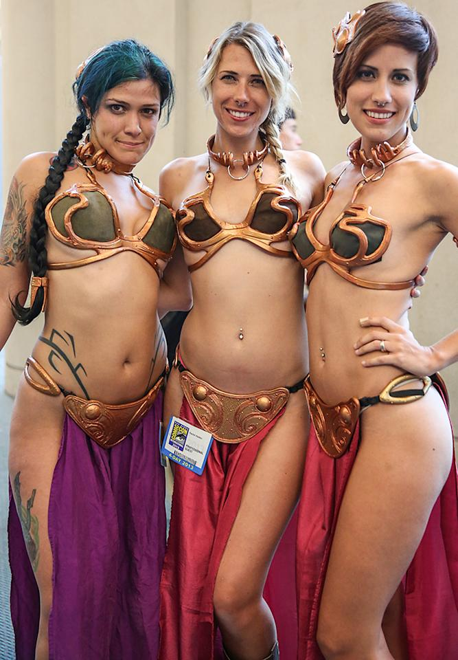 SAN DIEGO, CA - JULY 19: Fans in costume attend day 2 of Comic-Con International on July 19, 2013 in San Diego, California.  (Photo by Chelsea Lauren/WireImage)