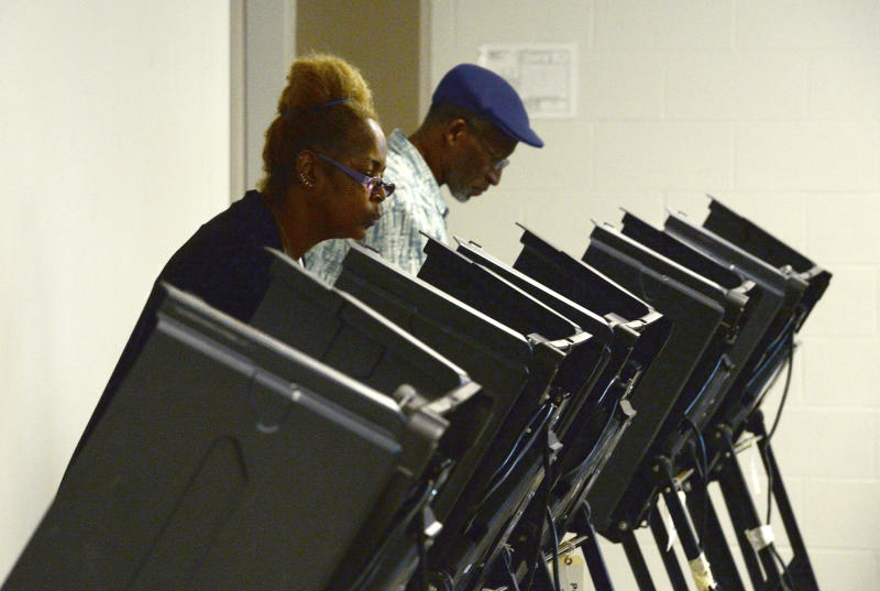 Tanya Archie-Younge, 56 and her husband, Jesse Younge, 62, cast their ballots at Precinct #25 at the West Charlotte Recreation Center Tuesday, September 10, 2019. Voters across Charlotte and the region went to the polls to vote in local Democrat and Republican primaries, while others, in the now infamous 9th District, voted to send either Dan McCready or Dan Bishop to represent them in Congress.  (John D. Simmons/The Charlotte Observer via AP)