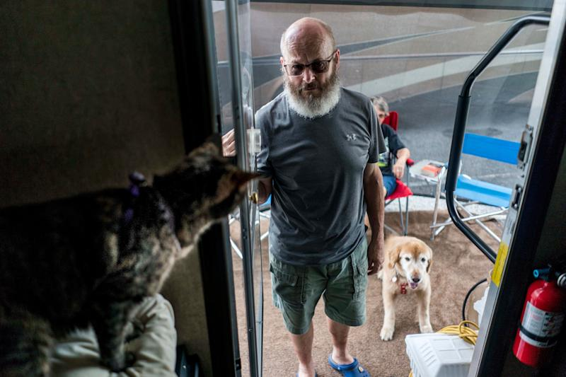 Marge and Steve Durham, with their dog Seti and Saba the cat, from Myrtle Beach South Carolina park their RVs and settle into the Family Campground section of the Atlanta Motor Speedway which has been made available for evacuees fleeing Hurricane Florence's path in Hampton Georgia on Thursday September 13, 2018.