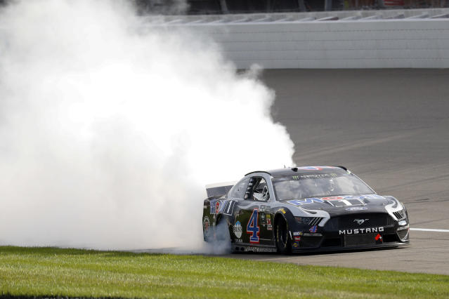 Kevin Harvick celebrates after winning a NASCAR Cup Series auto race at Michigan International Speedway in Brooklyn, Mich., Sunday, Aug. 11, 2019. (AP Photo/Paul Sancya)