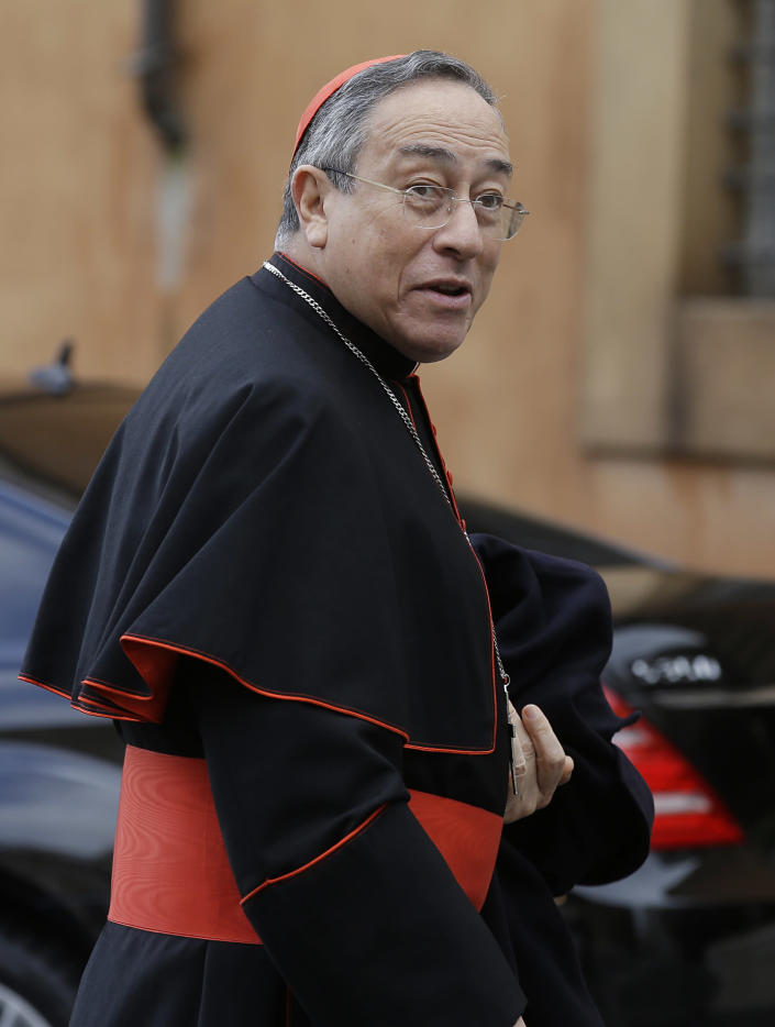 Cardinal Oscar Andres Rodriguez Maradiaga arrives for a meeting, at the Vatican, Saturday, March 9, 2013. The preliminaries over, Catholic cardinals are ready to get down to the real business of choosing a pope. And even without a front-runner, there are indications they will go into the conclave Tuesday with a good idea of their top picks. The conclave date was set Friday during a vote by the College of Cardinals, who have been meeting all week to discuss the church's problems and priorities, and the qualities the successor to Pope Benedict XVI must possess. (AP Photo/Gregorio Borgia)