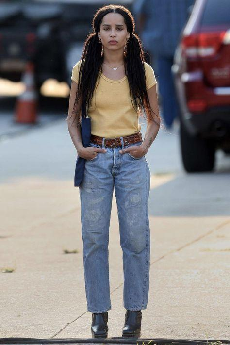 """<p>Zoe is THE cool girl. In her most recent role in Hulu's <em>High Fidelity,</em> she took a note from her mom's book wearing micro braids. """"The struggle's always been real for me and my hair, but I really prefer my hair being natural,"""" Zoe said in an interview with<a href=""""https://www.refinery29.com/en-us/2017/03/143667/zoe-kravitz-hair-makeup-best-beauty-looks"""" rel=""""nofollow noopener"""" target=""""_blank"""" data-ylk=""""slk:Refinery 29"""" class=""""link rapid-noclick-resp""""> <em>Refinery 29</em></a>. The stylish actress has always made a point to be authentically herself and many of the characters she plays wear their hair natural. She also isn't afraid to try something new and has shown us that you can do so much with box braids, from edgy updos to classic beehives and everything in between. </p>"""