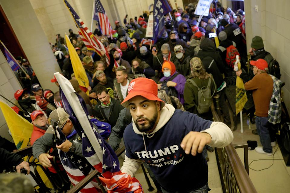 Protesters enter the Capitol on Jan. 6 in Washington as Congress held a joint session to ratify President-elect Joe Biden's 306-232 Electoral College win over President Donald Trump.