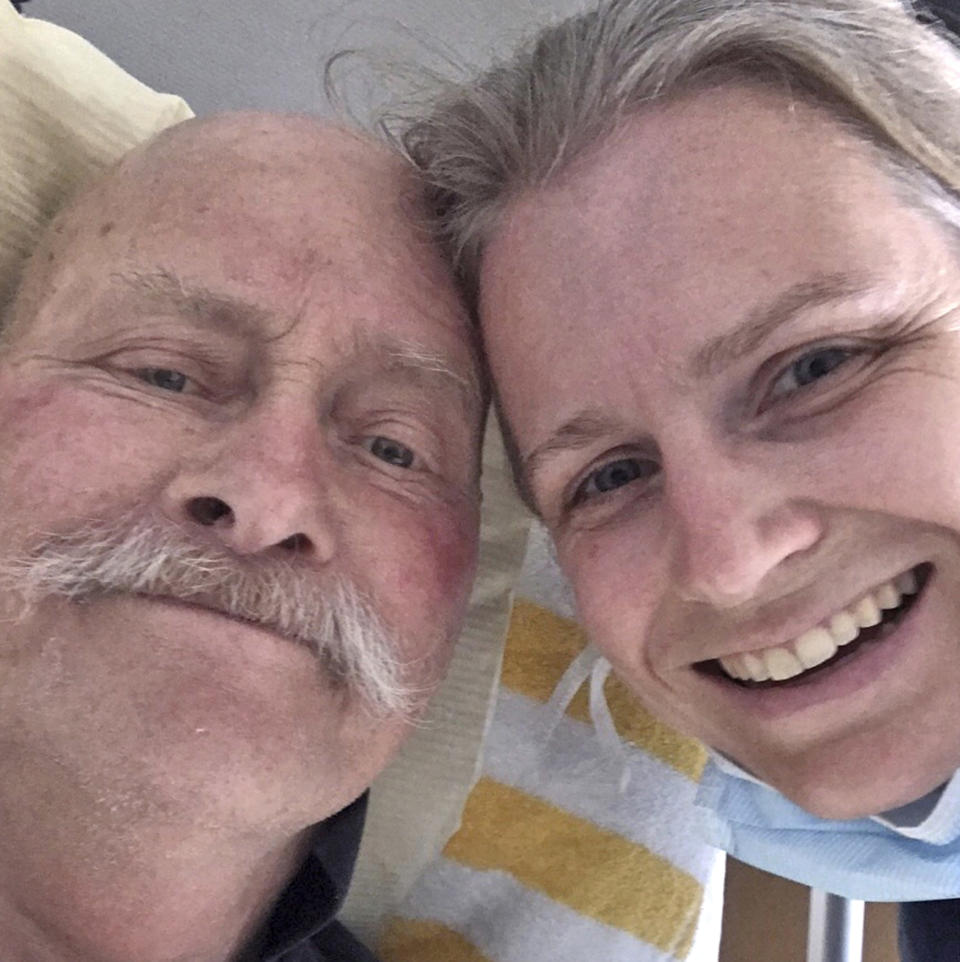 In this photo released by Astrid Magenau, Magenau poses for a photo with her father in Stuttgart, Germany on June 6, 2020. Magenau wasn't able to keep a promise to hold her father's hand at his deathbed in Germany because of Australia's extraordinary pandemic restrictions that make her feel like a prisoner in her adopted country. (Astrid Magenau via AP)