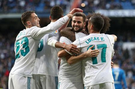 Soccer Football - La Liga Santander - Real Madrid vs Deportivo La Coruna - Santiago Bernabeu, Madrid, Spain - January 21, 2018 Real Madrid's Nacho celebrates scoring their seventh goal with teammates REUTERS/Sergio Perez