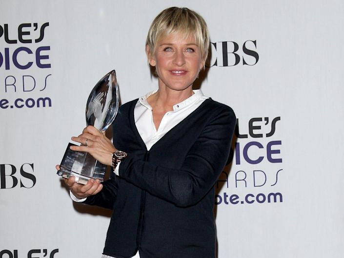 TV personality Ellen DeGeneres poses with the Favorite Talk Show Host award in the press room at the 35th Annual People's Choice Awards