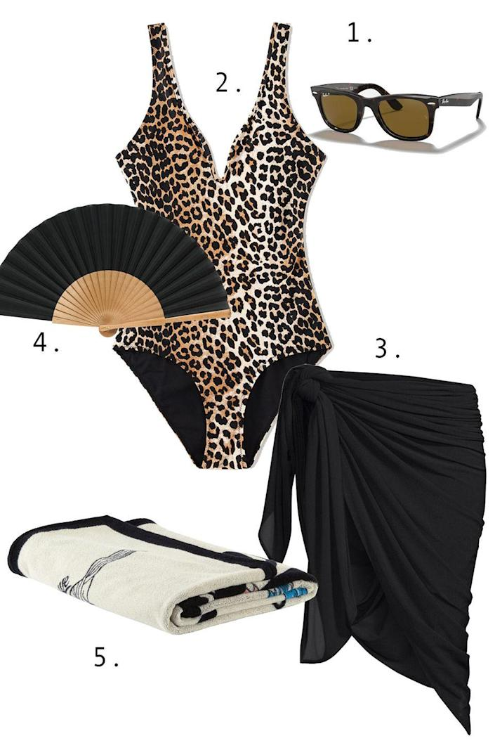 """<p>A good animal print never goes out of style. But because a leopard print really does the talking for you, you want to keep the sultry look fairly pared down in the form of a pareo (preferably black, or maybe white), a classic pair of shades, a fan, and a stylish towel.</p><ol><li>R<a href=""""https://go.skimresources.com?id=74968X1525087&xs=1&url=https%3A%2F%2Fwww.ray-ban.com%2Fusa%2Fsunglasses%2FRB2140%2520UNISEX%2520original%2520wayfarer%2520classic-tortoise%2F805289126652"""" rel=""""nofollow noopener"""" target=""""_blank"""" data-ylk=""""slk:ay-Ban sunglasses"""" class=""""link rapid-noclick-resp"""">ay-Ban sunglasses</a> 2. <a href=""""https://go.skimresources.com?id=74968X1525087&xs=1&url=https%3A%2F%2Fwww.ganni.com%2Fus%2Frecycled-printed-plunge-swimsuit-A3357.html%3Fdwvar_A3357_color%3DLeopard"""" rel=""""nofollow noopener"""" target=""""_blank"""" data-ylk=""""slk:Ganni swim"""" class=""""link rapid-noclick-resp"""">Ganni swim</a> 3. <a href=""""https://go.skimresources.com?id=74968X1525087&xs=1&url=https%3A%2F%2Fwww.saksfifthavenue.com%2Fproduct%2Fnorma-kamali-ernie-multi-way-oversized-sarong-0474227281083.html%3Fdwvar_0474227281083_color%3DBLACK"""" rel=""""nofollow noopener"""" target=""""_blank"""" data-ylk=""""slk:Norma Kamali sarong"""" class=""""link rapid-noclick-resp"""">Norma Kamali sarong</a> 4. <a href=""""https://go.skimresources.com?id=74968X1525087&xs=1&url=https%3A%2F%2Fwww.fernfans.com%2Fshop%2Fmedium-solid-fan-in-black"""" rel=""""nofollow noopener"""" target=""""_blank"""" data-ylk=""""slk:Fern Fans fan"""" class=""""link rapid-noclick-resp"""">Fern Fans fan</a> 5. <a href=""""https://go.skimresources.com?id=74968X1525087&xs=1&url=https%3A%2F%2Fwww.ssense.com%2Fen-us%2Feverything-else%2Fproduct%2Floewe%2Foff-white-paulas-ibiza-edition-parrot-beach-towel%2F6939241"""" rel=""""nofollow noopener"""" target=""""_blank"""" data-ylk=""""slk:Loewe beach towel"""" class=""""link rapid-noclick-resp"""">Loewe beach towel</a></li></ol>"""
