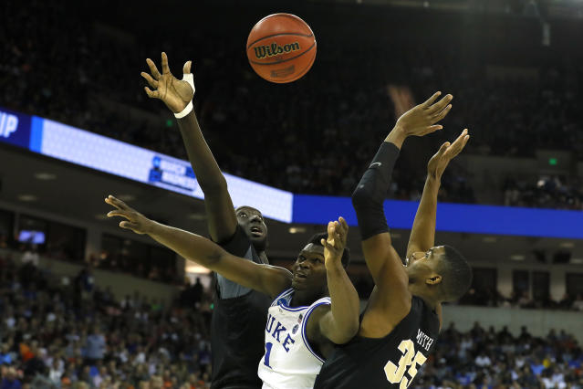 <p>Zion Williamson #1 of the Duke Blue Devils rebounds against Tacko Fall #24 and Collin Smith #35 of the UCF Knights during the second half in the second round game of the 2019 NCAA Men's Basketball Tournament at Colonial Life Arena on March 24, 2019 in Columbia, South Carolina. (Photo by Kevin C. Cox/Getty Images) </p>
