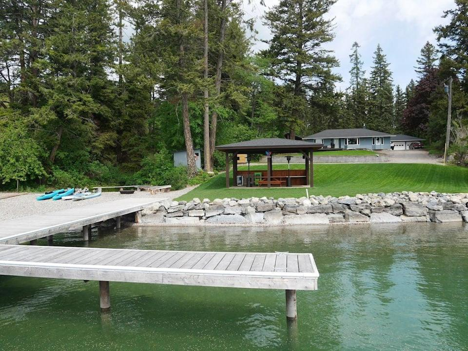 """<h2>Flathead Lake Cabin</h2><br><strong>Location: </strong>Rollins, Montana<br><strong>Sleeps: </strong>6<br><strong>Price Per Night: </strong>$150<br><em>Check availability <strong><a href=""""http://airbnb.pvxt.net/jWWMNa"""" rel=""""nofollow noopener"""" target=""""_blank"""" data-ylk=""""slk:here"""" class=""""link rapid-noclick-resp"""">here</a></strong></em><br><br>""""Modern, two-bedroom cabin on west shore of Flathead Lake located 25 miles north of Polson and 25 miles south of Kalispell. Includes beautiful lawn area with pavilion/gazebo, private dock with cleats for your boat or a rental, private beach with amazing fire pit. Sleeps four to six with one queen bed in master bedroom, and one double bed and a set of bunk beds in second bedroom. Large private yard with creek bordering, so you can listen from front deck or master bedroom window."""" <br>"""