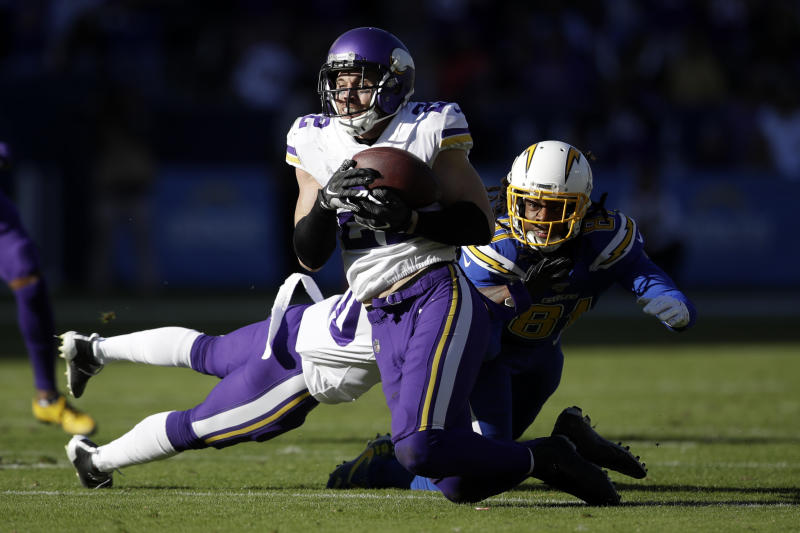 Minnesota Vikings free safety Harrison Smith , front,intercepts a pass intended for Los Angeles Chargers wide receiver Mike Williams, right, during the first half of an NFL football game Sunday, Dec. 15, 2019, in Carson, Calif. (AP Photo/Marcio Jose Sanchez)