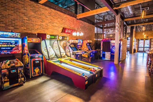 Classic arcade games can be found at Punch Bowl Socials. [Photo credit: Amber Boutwell, Punch Bowl Social]