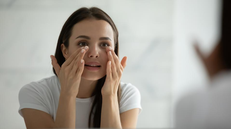 Adding an eye cream to my skincare routine helped my makeup last longer throughout the day. (Image via Getty Images)