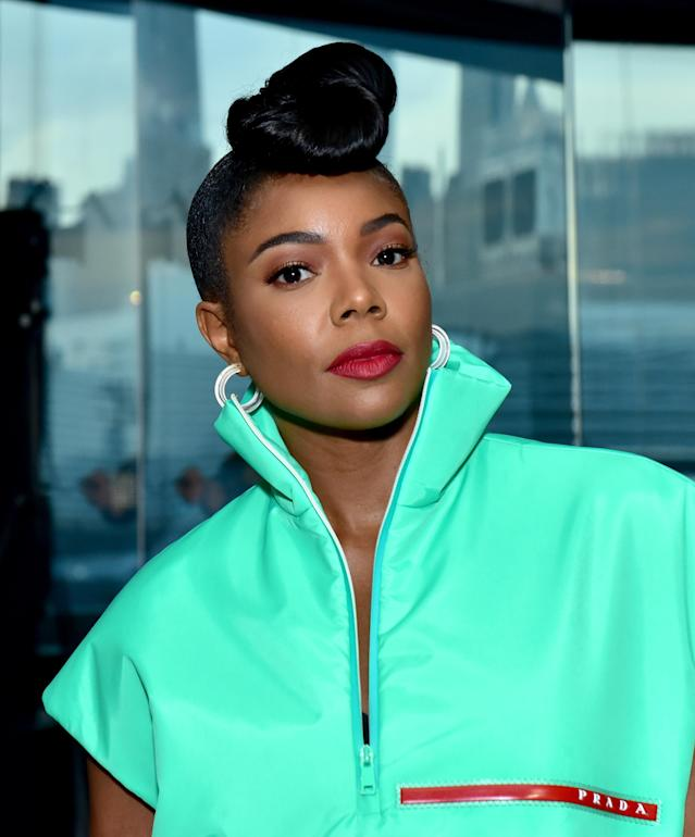 <p>Actress Gabrielle Union-Wade attends the Prada Resort 2019 fashion show wearing the small jelly hoop earrings in white by Alison Lou on May 4, 2018, in New York City. (Photo: Sean Zanni/Getty Images) </p>