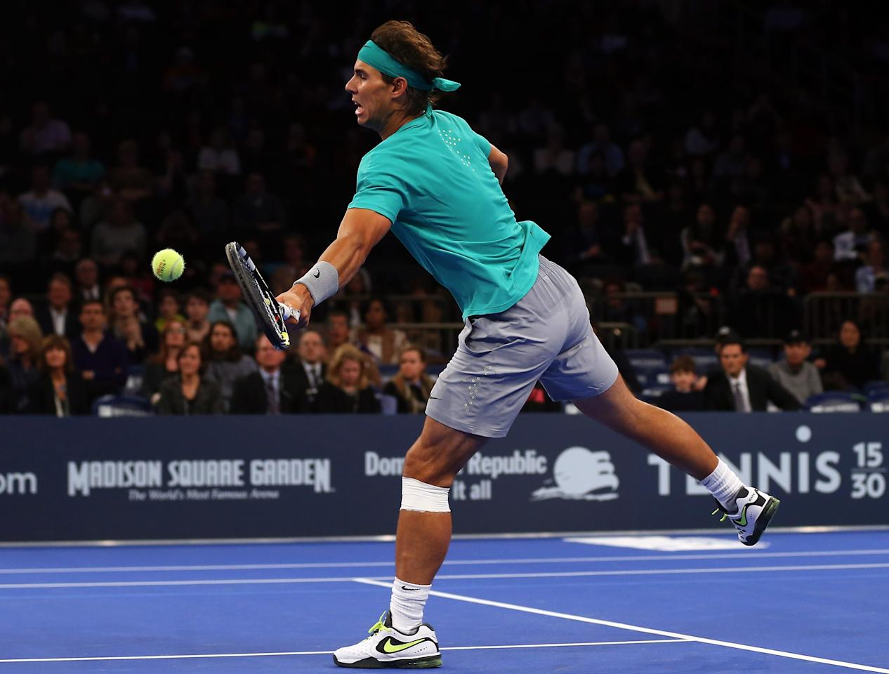 NEW YORK, NY - MARCH 04:  Rafael Nadal of Spain returns a shot to Juan del Potro of Argentina during the BNP Paribas Showdown on March 4, 2013 at Madison Square Garden in New York City.  (Photo by Elsa/Getty Images)