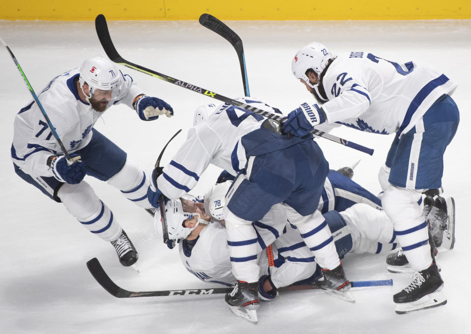 Toronto Maple Leafs' TJ Brodie (78) celebrates his goal against the Montreal Canadiens with teammates during the third period of Game 6 of an NHL hockey Stanley Cup first-round playoff seres Saturday, May 29, 2021, in Montreal. (Ryan Remiorz/The Canadian Press via AP)