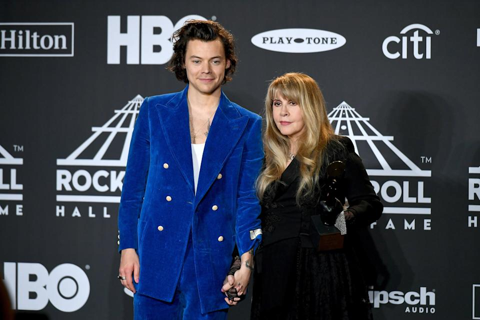 Harry wore this beautiful cerulean blue double-breasted Gucci suit at the 2019 Rock and Roll Hall of Fame Induction. The perfect outfit for one rock icon to induct another into the Hall of Fame. And this is the one now going into a museum.